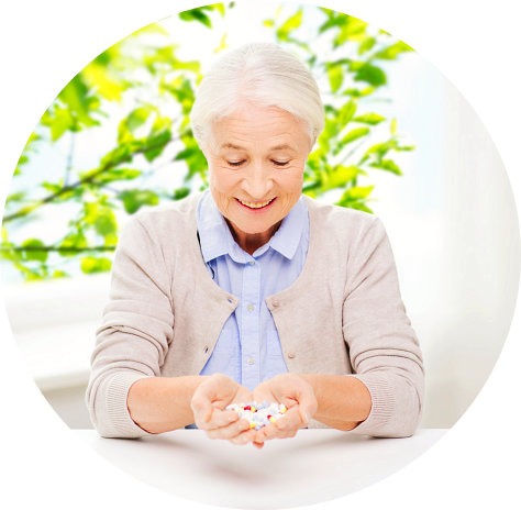 elderly woman with a medicines on her hands