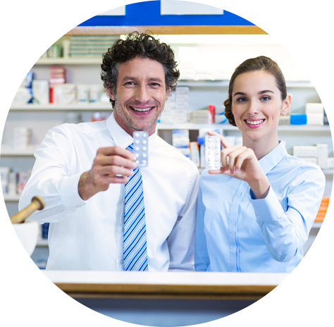 two pharmacists holding a medicine