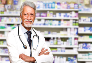 pharmacist crossing his arms